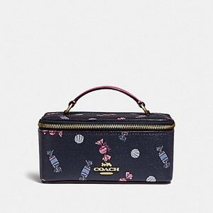 VANITY CASE WITH SCATTERED CANDY PRINT